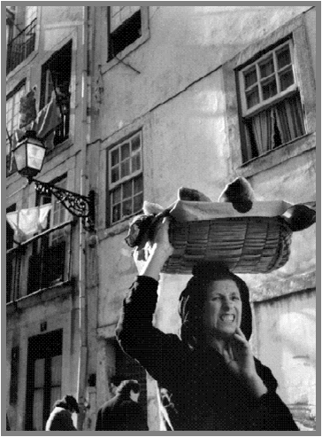 A varina, or fishmonger, traditionally carries her wares in a basket on her head.