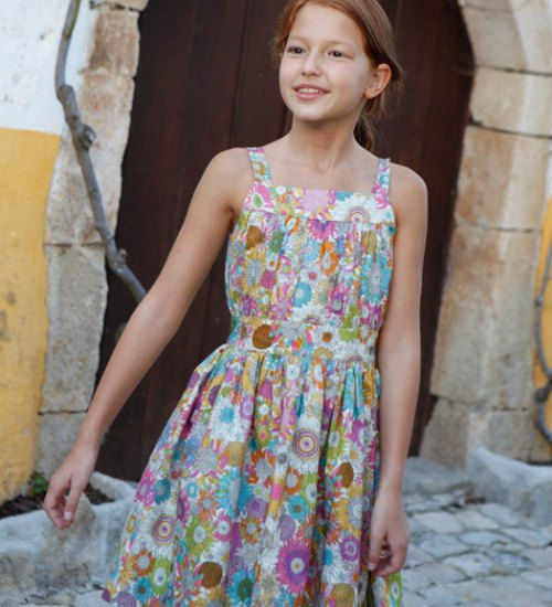 If your daughter balks at wearing something classic, let her try the Gathered Sleeveless Dress with jeans or leggings.